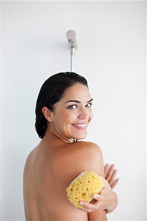 Pretty brunette woman enjoying a shower Stock Photo - Premium Royalty-Free, Code: 6108-08909548