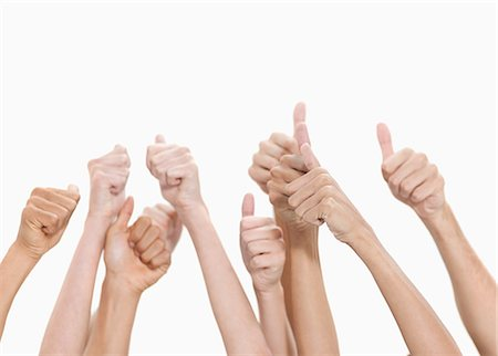 Thumbs up and hands raised against white background Stock Photo - Premium Royalty-Free, Code: 6109-06002868
