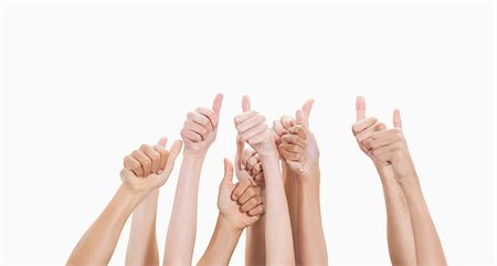 Five pairs of arms with the thumbs up against white background Stock Photo - Premium Royalty-Free, Code: 6109-06002869