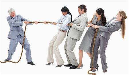 Boss pulling a rope against his employees with white background Stock Photo - Premium Royalty-Free, Code: 6109-06002807