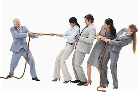 staff - Business people pulling a rope against their boss with white background Stock Photo - Premium Royalty-Free, Code: 6109-06002806