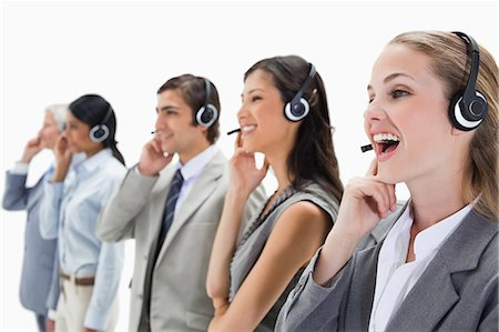 Professionals with headsets against white background Stock Photo - Premium Royalty-Free, Code: 6109-06002808