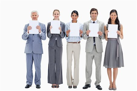 person holding sign - Business team holding five white placards against white background Stock Photo - Premium Royalty-Free, Code: 6109-06002828