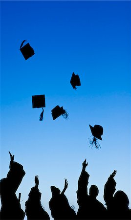 Students celebrating their graduation while throwing their hats Stock Photo - Premium Royalty-Free, Code: 6109-06003587