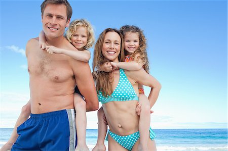 Happy young family having a nice day on the beach together Stock Photo - Premium Royalty-Free, Code: 6109-06003649