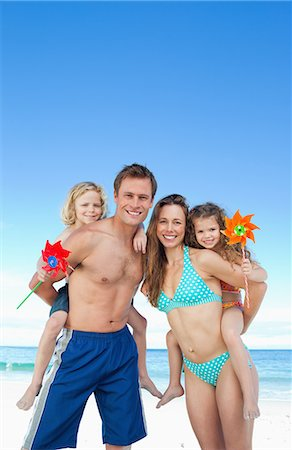 Jolly young family spending their day on the beach Stock Photo - Premium Royalty-Free, Code: 6109-06003651