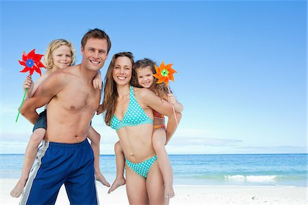 Jolly young family spending their time on the beach Stock Photo - Premium Royalty-Free, Code: 6109-06003652