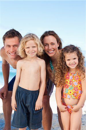 Happy young family spending their time on the beach Stock Photo - Premium Royalty-Free, Code: 6109-06003627