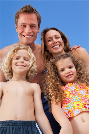 Smiling young family spending their time on the beach Stock Photo - Premium Royalty-Free, Code: 6109-06003630