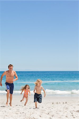 family active beach - Young father running with his little children on the beach Stock Photo - Premium Royalty-Free, Code: 6109-06003758