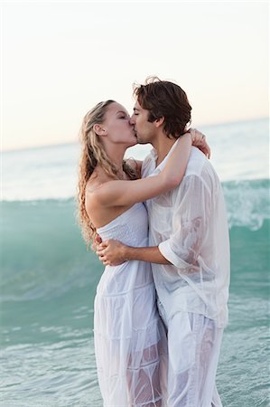 Kissing young couple standing in the sea Stock Photo - Premium Royalty-Free, Code: 6109-06003844