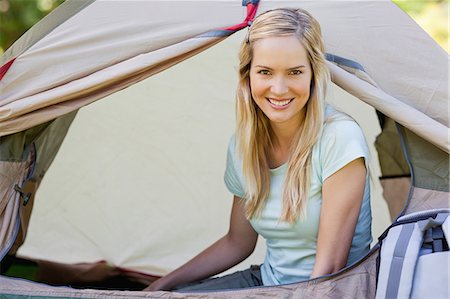 A woman inside of the tent while she looks straight ahead at the camera Stock Photo - Premium Royalty-Free, Code: 6109-06003896