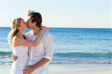 Young couple kissing on the beach Stock Photo - Premium Royalty-Free, Code: 6109-06003801