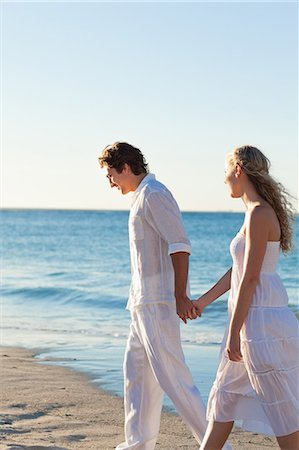 Happy young couple walking at the seaside Stock Photo - Premium Royalty-Free, Code: 6109-06003833