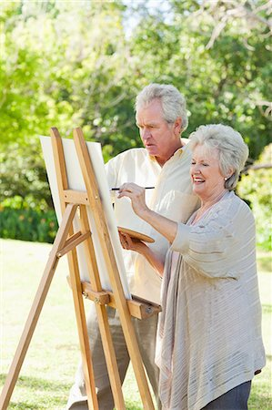 painter - Man and a woman painting in a park Stock Photo - Premium Royalty-Free, Code: 6109-06004808