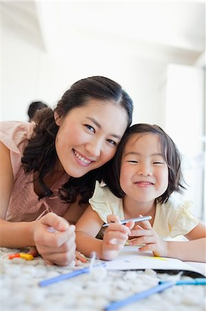 pretty pictures to draw - Mother and daughter take a break from colouring and look up to smile Stock Photo - Premium Royalty-Free, Code: 6109-06004906