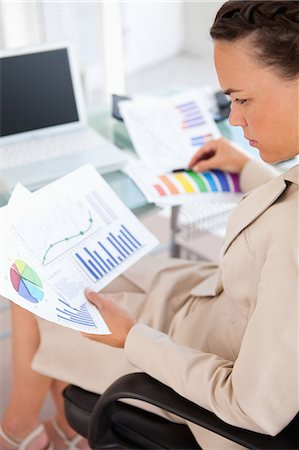 report - Businesswoman looking diagrams in a bright office Stock Photo - Premium Royalty-Free, Code: 6109-06005443