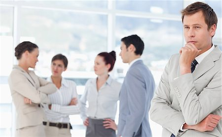 staff - Thoughtful young salesman with colleagues behind him Stock Photo - Premium Royalty-Free, Code: 6109-06005669