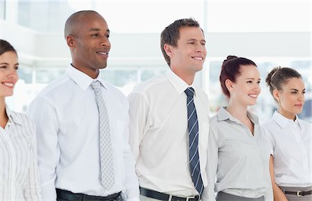 staff - Smiling young businessteam standing in a line Stock Photo - Premium Royalty-Free, Code: 6109-06005759
