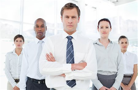 staff - Confident young businessman with his team Stock Photo - Premium Royalty-Free, Code: 6109-06005765