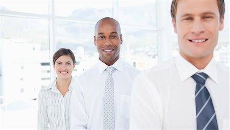 staff - Smiling young salespeople standing in a row Stock Photo - Premium Royalty-Free, Code: 6109-06005771