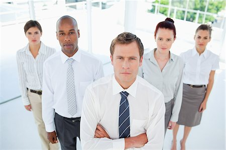staff - Salesman with his arms folded standing with his team Stock Photo - Premium Royalty-Free, Code: 6109-06005779
