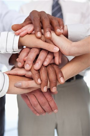 piles of work - Several hands put together for teamwork gesture Stock Photo - Premium Royalty-Free, Code: 6109-06005790