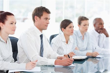 staff - Young salespeople sitting in a meeting Stock Photo - Premium Royalty-Free, Code: 6109-06005825