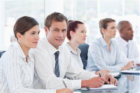 staff - Young salesteam sitting in a meeting Stock Photo - Premium Royalty-Free, Code: 6109-06005829