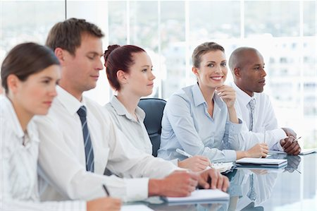 staff - Young salesteam having a meeting Stock Photo - Premium Royalty-Free, Code: 6109-06005831