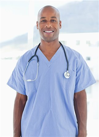 Smiling male doctor standing Stock Photo - Premium Royalty-Free, Code: 6109-06005913
