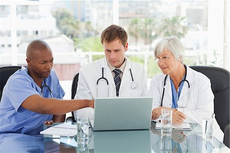 Doctors working on laptop together Stock Photo - Premium Royalty-Free, Code: 6109-06006473