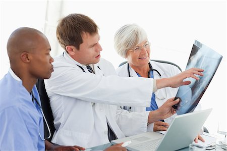 staff - Doctors together in meeting room looking at an x-ray Stock Photo - Premium Royalty-Free, Code: 6109-06006479