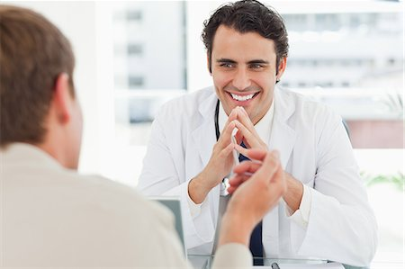 Man talking with his young doctor Stock Photo - Premium Royalty-Free, Code: 6109-06006554