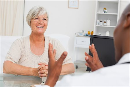 Happy mature woman got good news from her doctor Stock Photo - Premium Royalty-Free, Code: 6109-06006677