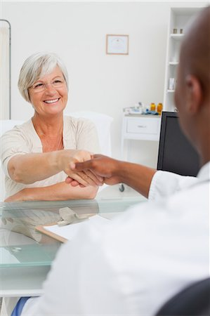 Doctor welcoming his mature patient Stock Photo - Premium Royalty-Free, Code: 6109-06006680