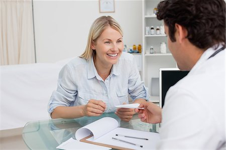 Happy smiling woman getting prescription from her doctor Stock Photo - Premium Royalty-Free, Code: 6109-06006706