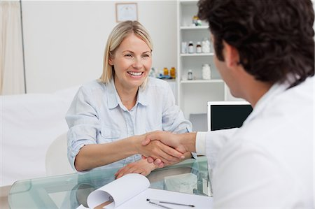 Happy smiling woman shaking her doctors hand Stock Photo - Premium Royalty-Free, Code: 6109-06006708