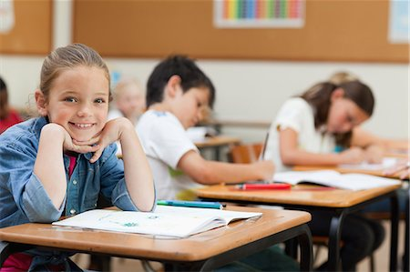 Side view of happy young schoolgirl during class Stock Photo - Premium Royalty-Free, Code: 6109-06007467