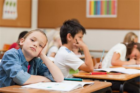 Side view of bored young schoolgirl Stock Photo - Premium Royalty-Free, Code: 6109-06007470