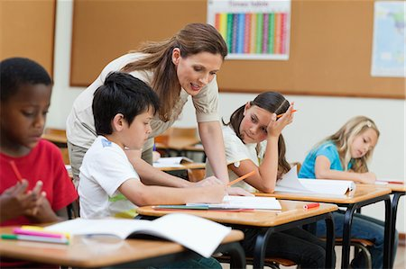 Side view of helpful elementary teacher Stock Photo - Premium Royalty-Free, Code: 6109-06007484