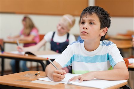 studying (all students) - Primary student looking at the blackboard Stock Photo - Premium Royalty-Free, Code: 6109-06007430