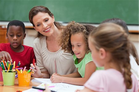 pretty draw - Smiling elementary teacher painting together with students Stock Photo - Premium Royalty-Free, Code: 6109-06007584