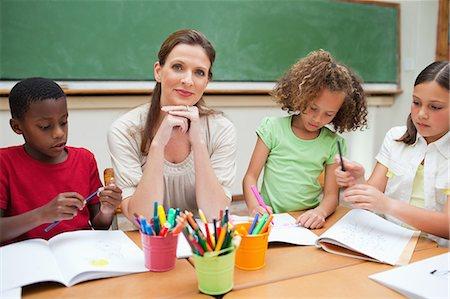 draw black women - Elementary teacher giving art class Stock Photo - Premium Royalty-Free, Code: 6109-06007586