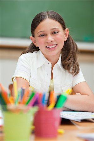 pretty pictures to draw - Smiling elementary student next to pencil holders Stock Photo - Premium Royalty-Free, Code: 6109-06007595