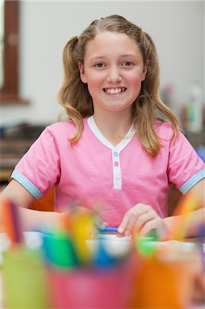 pretty draw - Smiling little girl sitting at desk during art class Stock Photo - Premium Royalty-Free, Code: 6109-06007598