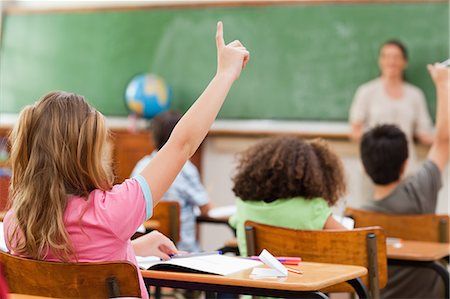 school desk - Back view of little girl raising hand in class Stock Photo - Premium Royalty-Free, Code: 6109-06007521