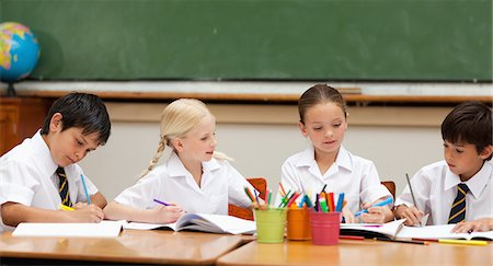 pretty draw - Little schoolchildren in school uniforms painting at desk Stock Photo - Premium Royalty-Free, Code: 6109-06007616