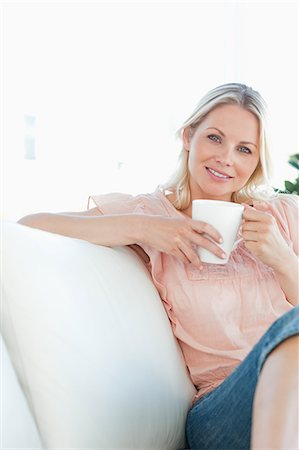 Smiling blond woman with a coffee Stock Photo - Premium Royalty-Free, Code: 6109-06194242