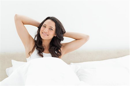 Attractive brunette waking up Stock Photo - Premium Royalty-Free, Code: 6109-06194213